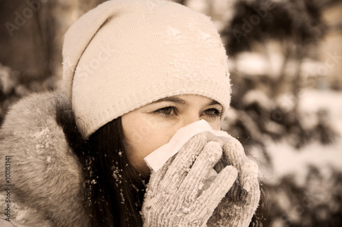 Photo  Girl with handkerchief has the flu and running nose winter