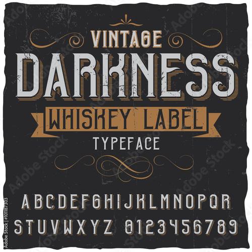 Fototapeta Whiskey label font and sample label design with decoration and ribbon. Vintage font. Whiskey font. Fine label font. Handcrafted font. Decoration font. Font style. Retro font. Old font. Stylized font. obraz
