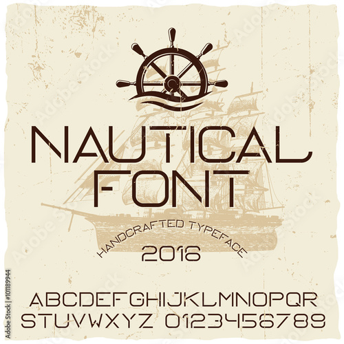 Fotografia  Nautical hand crafted typeface with vector ship on background.
