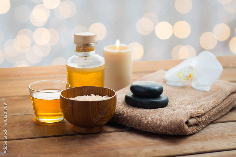 Fototapeta close up of salt, massage oil and bath stuff