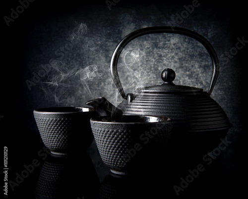 Photo  Teapot with cups