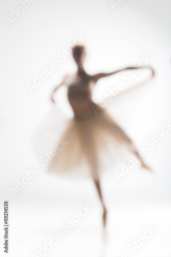 Fotografie, Obraz  Blurred silhouette of ballerina on white background