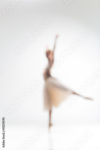 Fényképezés  Blurred silhouette of ballerina on white background