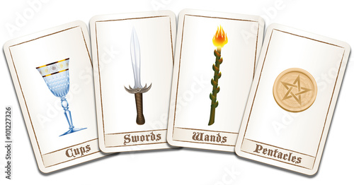 Tarot cards fanned out with four suits: wands, coins, swords and