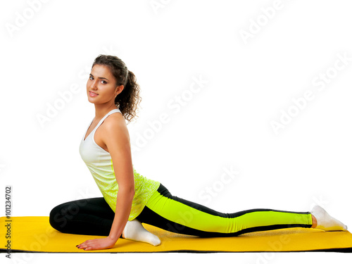 Fotografering  woman doing yoga exercise