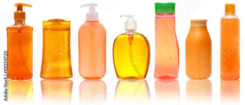 Fotografie, Obraz  Seven orange  Plastic Bottles With Shampoo, Liquid Soap, Shower Gel