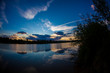 blue evening sky and smooth water surface