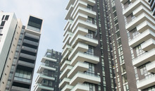 Modern High Rise Apartment Buildings In City