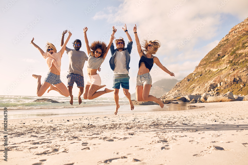 Fototapety, obrazy: Group of friends on the beach having fun