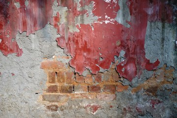 FototapetaOld concrete wall with exposed bricks