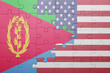 canvas print picture - puzzle with the national flag of united states of america and  eritrea