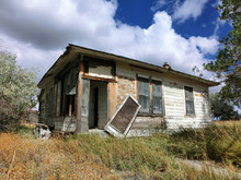 Abandoned Prairie Shack With Broken Windows And Door - Landscape Photo
