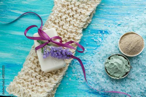 Fototapeta natural organic soap and sea salt herbal bath  on a blue wooden table, with flowers obraz na płótnie