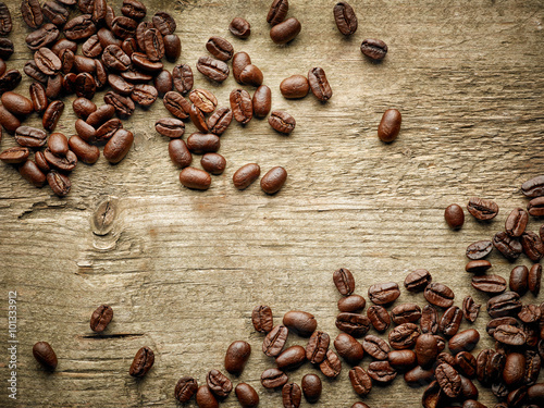 Coffee beans on wooden table - 101333912