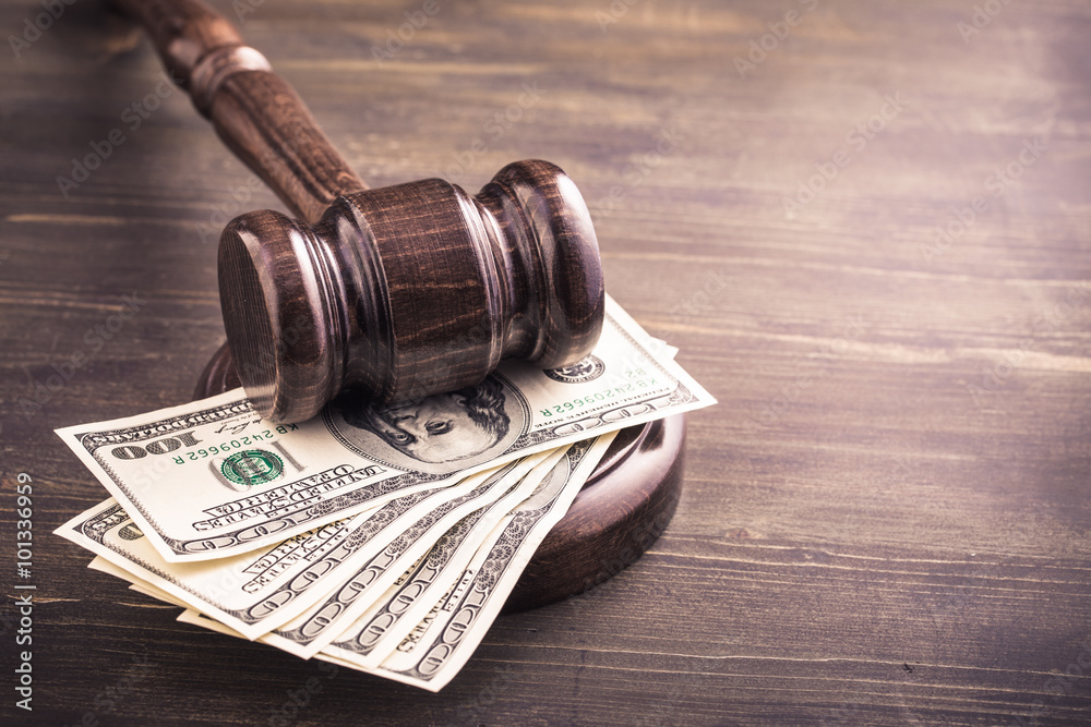 Fototapety, obrazy: Gavel and dollars banknotes on table