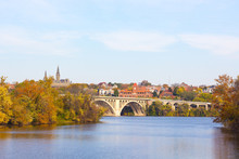 A View On Key Bridge And Historic Buildings Across Potomac River In Autumn. Fall Colors Of Potomac Riverside At Georgetown Suburb Of Washington DC, USA.