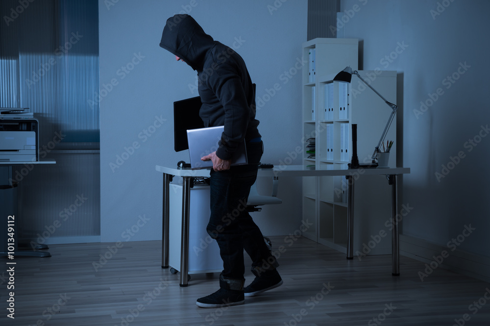 Fototapeta Robber Stealing Laptop From Office At Night