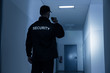 canvas print picture - Security Guard With Flashlight In Building Corridor