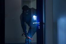Thief With Flashlight Trying T...