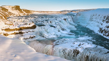 Gullfoss, Waterfall In Iceland In Winter With A Little Rainbow