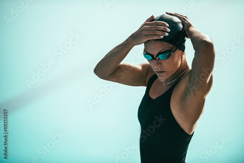 Attractive female swimmer, getting ready by the pool Canvas Print
