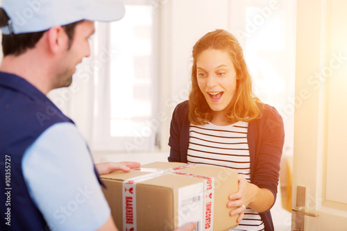 Fotografie, Obraz  Delivery man handing over a parcel to customer