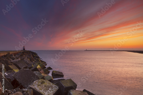 Fotografie, Obraz  Sunset over harbour entrance of IJmuiden, The Netherlands