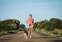 Sporty Woman And Dog Running T...