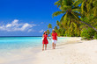 happy loving couple walking on summer beach