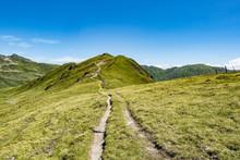 Winding Mountain Hiking Trail In Austrian Alps