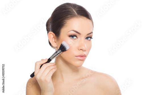 Fotografie, Obraz  Woman applying blusher
