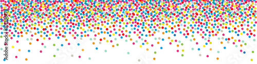 Photo  Polka dots paper colorful Confetti on a white background Banner.
