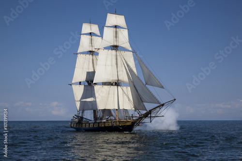 Foto op Plexiglas Schip Tall ship with cannons firing sailing on blue waters