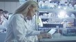 Female scientist is using a tablet while working in a laboratory. Shot on RED Cinema Camera.