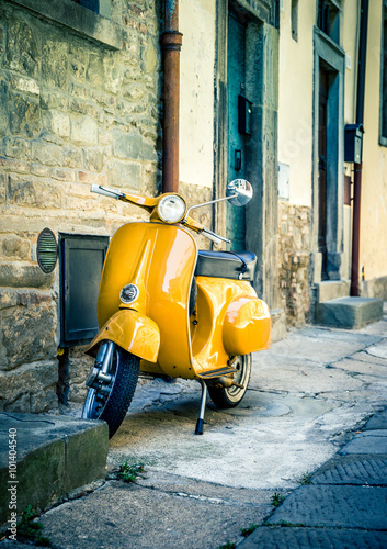 Fototapety, obrazy: Yellow scooter in tuscan Cortona town