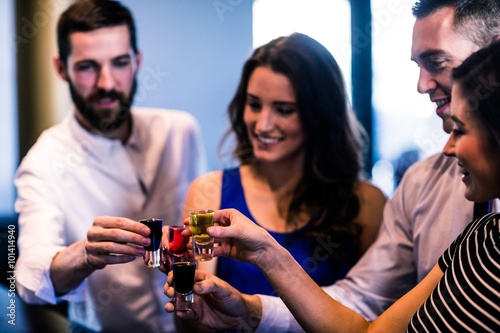 Friends toasting with alcohol shots Canvas Print
