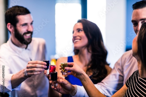 Friends toasting with alcohol shots Poster