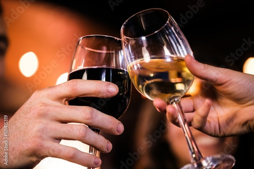 Close up of friends toasting with wine плакат