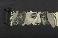 Benjamin Franklin Macro Peeking Through Torn Black Paper
