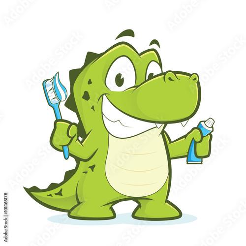 Fototapeta premium Crocodile or alligator holding toothbrush and toothpaste