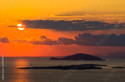 Foto op Plexiglas Indonesië Sunset at sea, with small greek islands in background, Sithonia, Greece