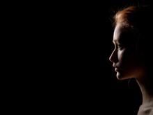Profile Of Sad Woman