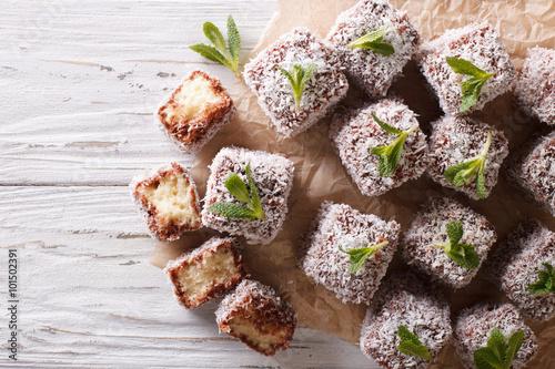 Fotografie, Obraz  Australian Lamington cake with coconut. Horizontal top view
