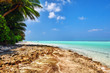 Shoreline of a tropical island in the Maldives and view of the I