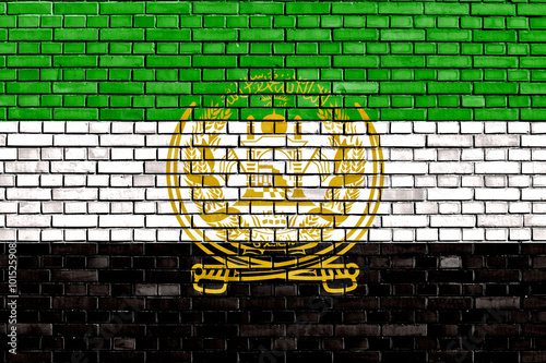 Fotografia  old flag of Afghanistan painted on brick wall
