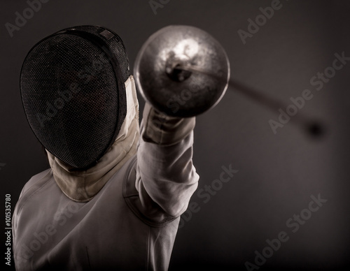 Portrait of woman wearing white fencing costume practicing with the sword фототапет
