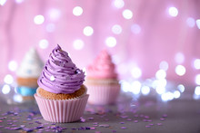 Cupcake With Purple Cream Icing On A Glitter Background