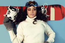Beautiful Skier Girl With Dark Hair Wears  Ski Equipment