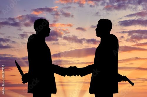 Cuadros en Lienzo Silhouette of two businessmen shaking hands