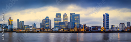 Poster London Panoramic skyline of Canary Wharf, the worlds leading financial district at blue hour - London, UK